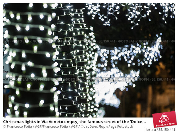 Christmas lights in Via Veneto empty, the famous street of the 'Dolce... Редакционное фото, фотограф Francesco Fotia / AGF/Francesco Fotia / AGF / age Fotostock / Фотобанк Лори
