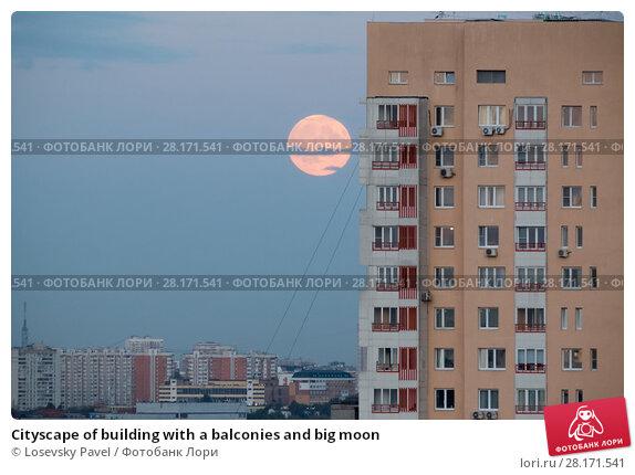 Купить «Cityscape of building with a balconies and big moon», фото № 28171541, снято 29 августа 2015 г. (c) Losevsky Pavel / Фотобанк Лори