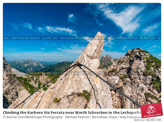 Climbing the Karhorn Via Ferrata near Warth Schrocken in the Lechquellen... Стоковое фото, фотограф Zoonar.com/MindScape Photography - Michael Pedrott / easy Fotostock / Фотобанк Лори