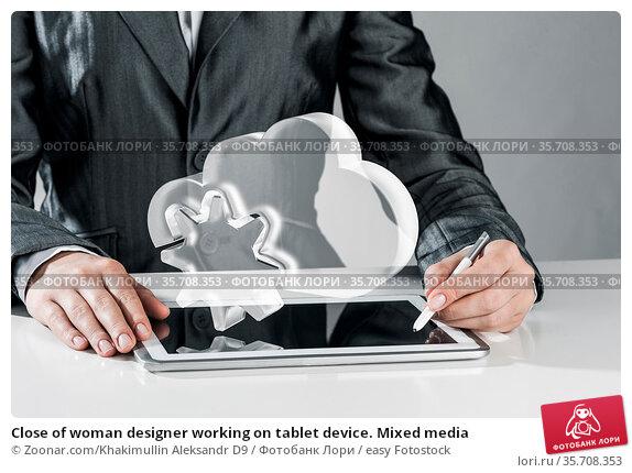 Close of woman designer working on tablet device. Mixed media. Стоковое фото, фотограф Zoonar.com/Khakimullin Aleksandr D9 / easy Fotostock / Фотобанк Лори