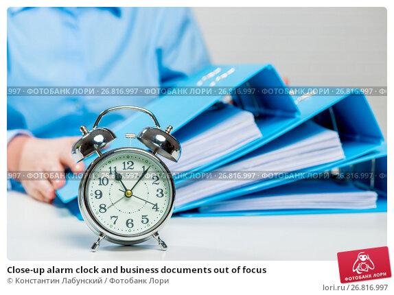 Купить «Close-up alarm clock and business documents out of focus», фото № 26816997, снято 26 февраля 2017 г. (c) Константин Лабунский / Фотобанк Лори