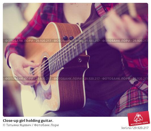 Купить «Close-up girl holding guitar.», фото № 29920217, снято 14 февраля 2017 г. (c) Татьяна Яцевич / Фотобанк Лори