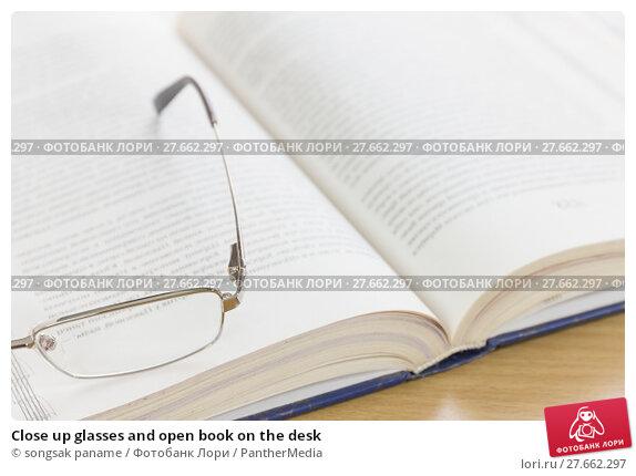 Купить «Close up glasses and open book on the desk», фото № 27662297, снято 22 мая 2019 г. (c) PantherMedia / Фотобанк Лори