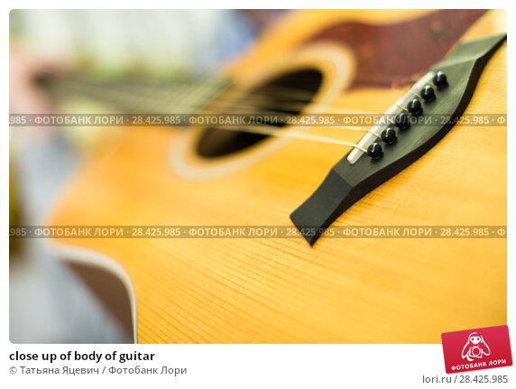 Купить «close up of body of guitar», фото № 28425985, снято 14 февраля 2017 г. (c) Татьяна Яцевич / Фотобанк Лори