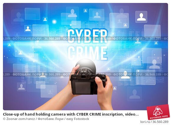 Close-up of hand holding camera with CYBER CRIME inscription, video... Стоковое фото, фотограф Zoonar.com/rancz / easy Fotostock / Фотобанк Лори