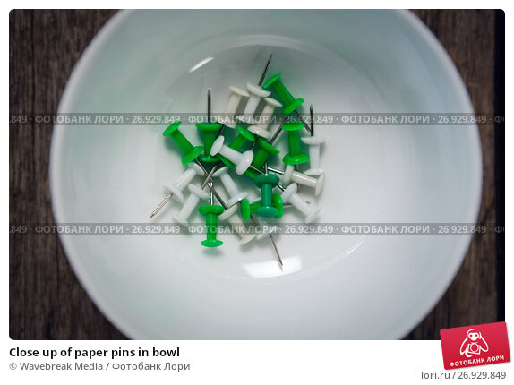 Купить «Close up of paper pins in bowl», фото № 26929849, снято 26 мая 2017 г. (c) Wavebreak Media / Фотобанк Лори