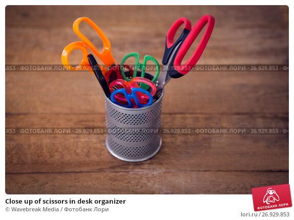 Close up of scissors in desk organizer, фото № 26929853, снято 26 мая 2017 г. (c) Wavebreak Media / Фотобанк Лори