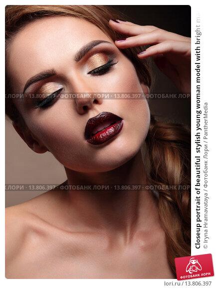 Купить «Closeup portrait of beautiful  stylish young woman model with bright makeup, with vinous lips. Makeup Face.  Beautiful Professional Holiday Make-up.», фото № 13806397, снято 22 апреля 2019 г. (c) PantherMedia / Фотобанк Лори