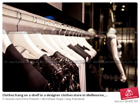 Clothes hang on a shelf in a designer clothes store in Melbourne,... Стоковое фото, фотограф Zoonar.com/Chris Putnam / easy Fotostock / Фотобанк Лори