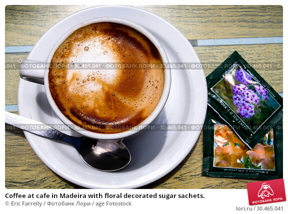 Coffee at cafe in Madeira with floral decorated sugar sachets. Стоковое фото, фотограф Eric Farrelly / age Fotostock / Фотобанк Лори