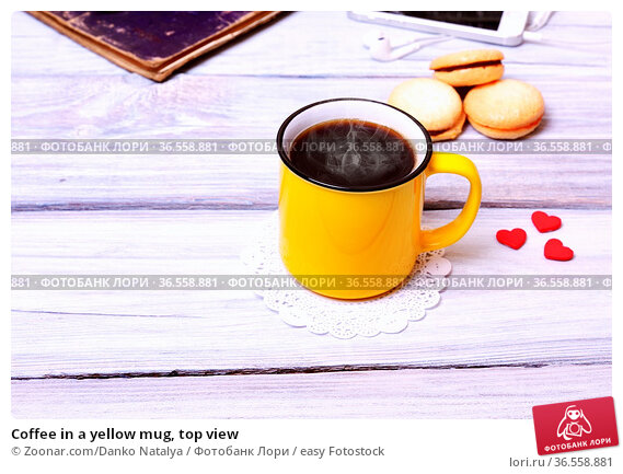 Coffee in a yellow mug, top view. Стоковое фото, фотограф Zoonar.com/Danko Natalya / easy Fotostock / Фотобанк Лори