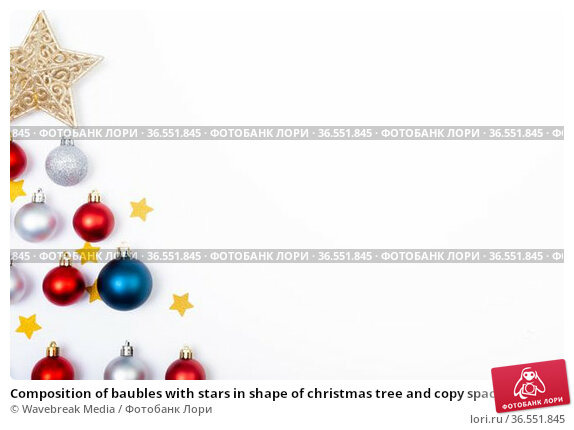 Composition of baubles with stars in shape of christmas tree and copy space on white background. Стоковое фото, агентство Wavebreak Media / Фотобанк Лори