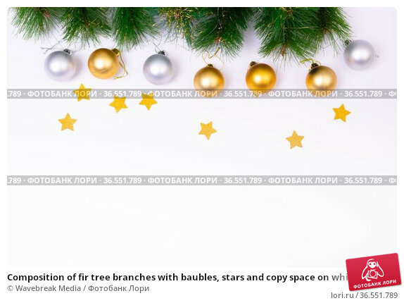 Composition of fir tree branches with baubles, stars and copy space on white background. Стоковое фото, агентство Wavebreak Media / Фотобанк Лори
