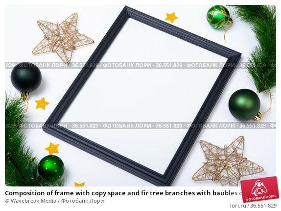 Composition of frame with copy space and fir tree branches with baubles on white background. Стоковое фото, агентство Wavebreak Media / Фотобанк Лори