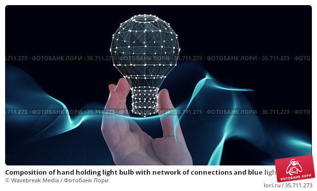 Composition of hand holding light bulb with network of connections and blue light trails. Стоковое фото, агентство Wavebreak Media / Фотобанк Лори