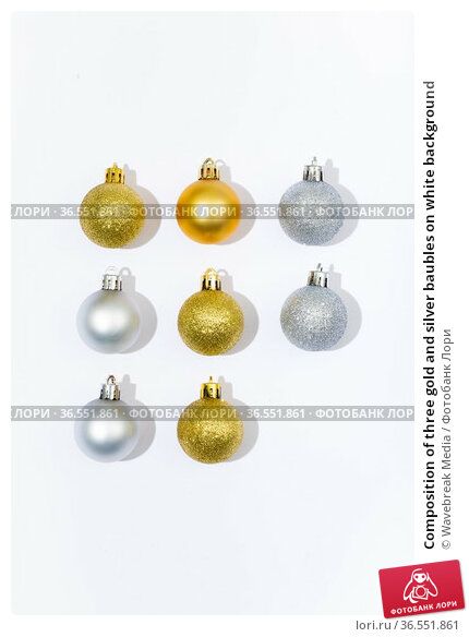 Composition of three gold and silver baubles on white background. Стоковое фото, агентство Wavebreak Media / Фотобанк Лори