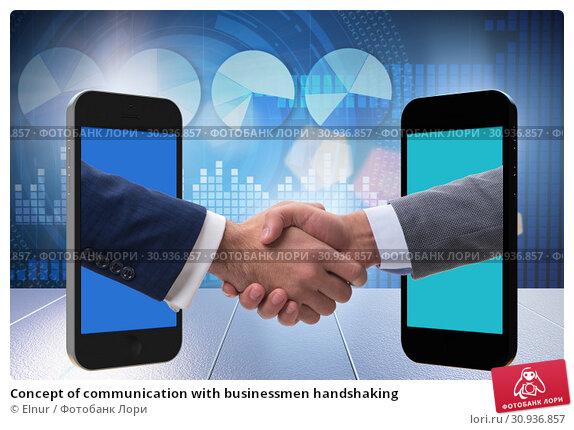 Concept of communication with businessmen handshaking. Стоковое фото, фотограф Elnur / Фотобанк Лори