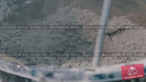 Купить «Concrete workshop - huge screw mixing dry concrete mix», видеоролик № 33449145, снято 5 июля 2020 г. (c) Константин Шишкин / Фотобанк Лори