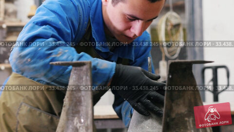 Купить «Concrete workshop - the master untwisting a concrete form with a screw», видеоролик № 33438245, снято 7 апреля 2020 г. (c) Константин Шишкин / Фотобанк Лори