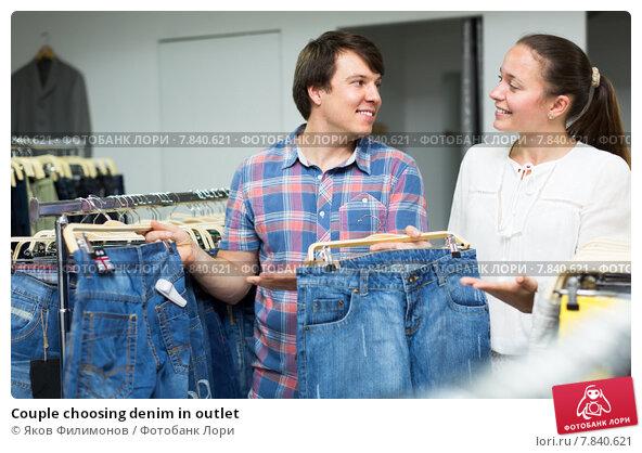 Купить «Couple choosing denim in outlet», фото № 7840621, снято 26 апреля 2019 г. (c) Яков Филимонов / Фотобанк Лори