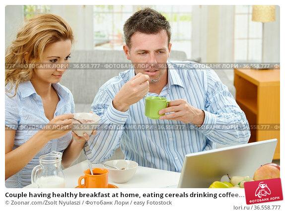 Couple having healthy breakfast at home, eating cereals drinking coffee... Стоковое фото, фотограф Zoonar.com/Zsolt Nyulaszi / easy Fotostock / Фотобанк Лори