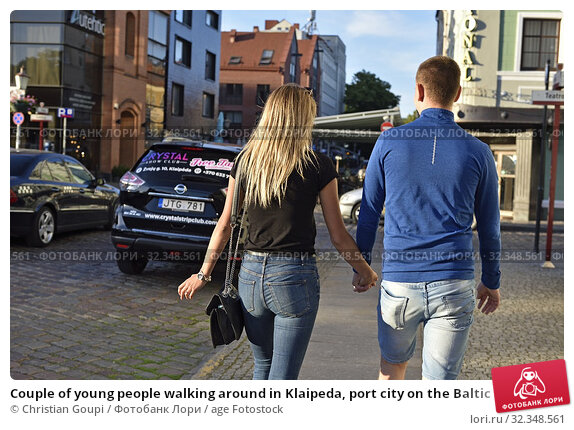 Купить «Couple of young people walking around in Klaipeda, port city on the Baltic Sea, Lithuania, Europe.», фото № 32348561, снято 23 июня 2019 г. (c) age Fotostock / Фотобанк Лори