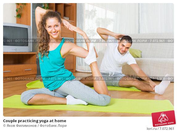 Couple practicing yoga at home. Стоковое фото, фотограф Яков Филимонов / Фотобанк Лори