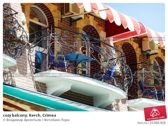 Купить «cozy balcony. Kerch, Crimea», фото № 33060929, снято 26 июня 2019 г. (c) Владимир Арсентьев / Фотобанк Лори