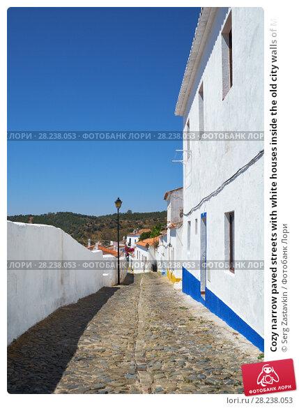 Купить «Cozy narrow paved streets with white houses inside the old city walls of Mertola. Beja. Portugal», фото № 28238053, снято 30 июня 2016 г. (c) Serg Zastavkin / Фотобанк Лори