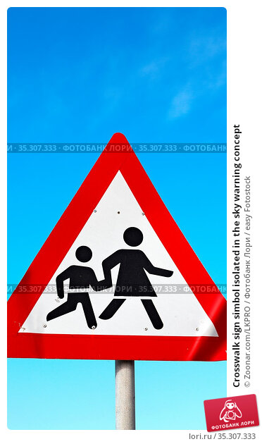Crosswalk sign simbol isolated in the sky warning concept. Стоковое фото, фотограф Zoonar.com/LKPRO / easy Fotostock / Фотобанк Лори