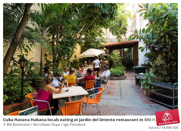 Купить «Cuba Havana Habana locals eating at Jardin del Oriente restaurant in Old Havana.», фото № 14900105, снято 22 июня 2018 г. (c) age Fotostock / Фотобанк Лори