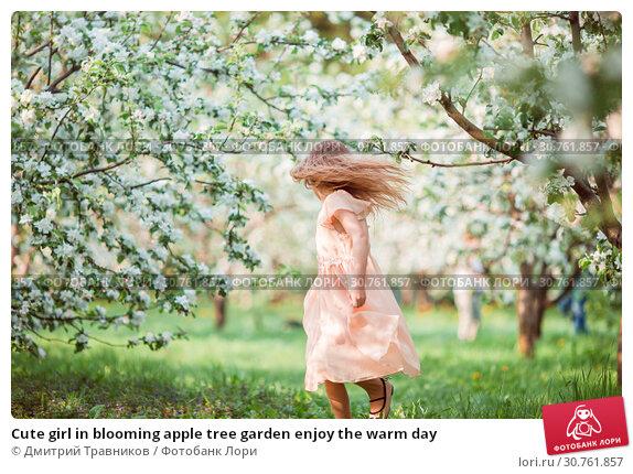 Купить «Cute girl in blooming apple tree garden enjoy the warm day», фото № 30761857, снято 10 мая 2016 г. (c) Дмитрий Травников / Фотобанк Лори