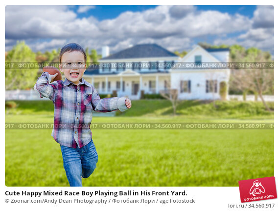 Cute Happy Mixed Race Boy Playing Ball in His Front Yard. Стоковое фото, фотограф Zoonar.com/Andy Dean Photography / age Fotostock / Фотобанк Лори