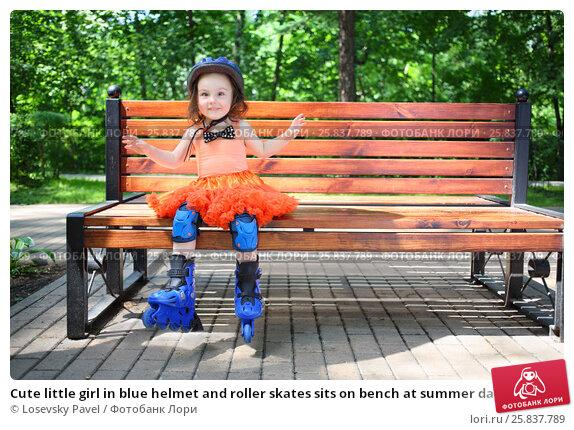 Купить «Cute little girl in blue helmet and roller skates sits on bench at summer day», фото № 25837789, снято 24 июня 2015 г. (c) Losevsky Pavel / Фотобанк Лори