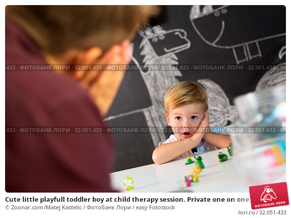 Cute little playfull toddler boy at child therapy session. Private one on one homeschooling with didactic aids. Стоковое фото, фотограф Zoonar.com/Matej Kastelic / easy Fotostock / Фотобанк Лори