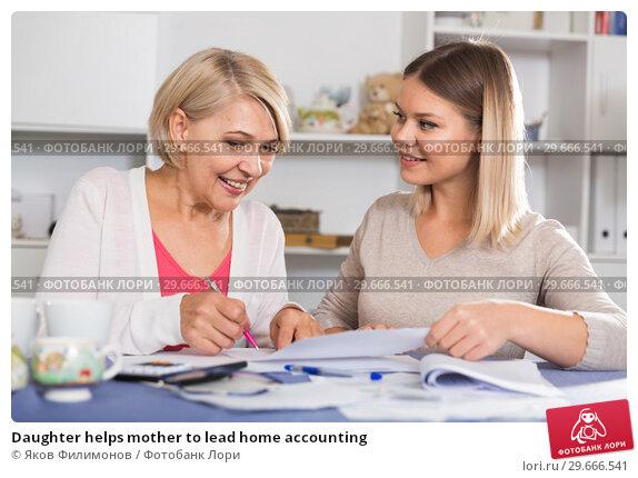 Купить «Daughter helps mother to lead home accounting», фото № 29666541, снято 13 ноября 2017 г. (c) Яков Филимонов / Фотобанк Лори