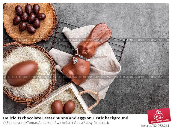 Delicious chocolate Easter bunny and eggs on rustic background. Стоковое фото, фотограф Zoonar.com/Tomas Anderson / easy Fotostock / Фотобанк Лори