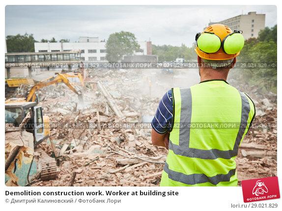 Купить «Demolition construction work. Worker at building site», фото № 29021829, снято 24 июля 2018 г. (c) Дмитрий Калиновский / Фотобанк Лори