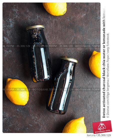 Detox activated charcoal black chia water or lemonade with lemon.... Стоковое фото, фотограф Zoonar.com/Olga Sergeeva / easy Fotostock / Фотобанк Лори