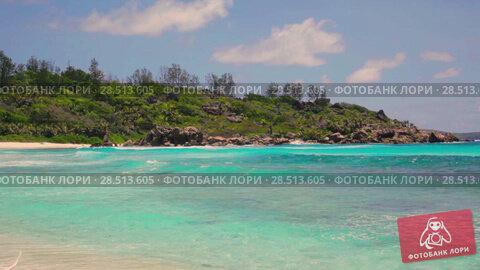 Купить «Died tree and small waves in white beach at Seychelles islands. La Digue, Anse Cocos», видеоролик № 28513605, снято 2 июня 2018 г. (c) Mikhail Starodubov / Фотобанк Лори