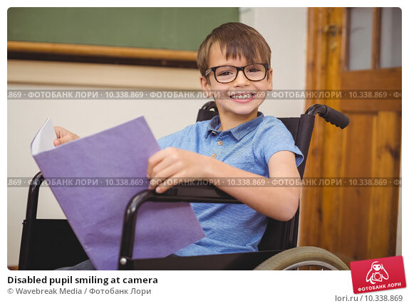 Купить «Disabled pupil smiling at camera», фото № 10338869, снято 7 июля 2015 г. (c) Wavebreak Media / Фотобанк Лори