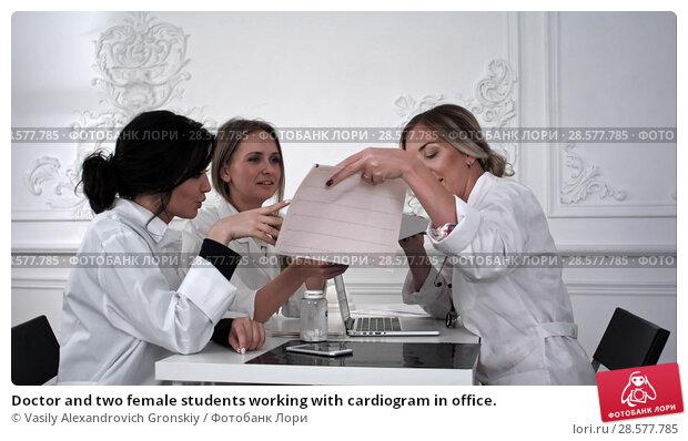 Купить «Doctor and two female students working with cardiogram in office.», фото № 28577785, снято 18 июня 2018 г. (c) Vasily Alexandrovich Gronskiy / Фотобанк Лори