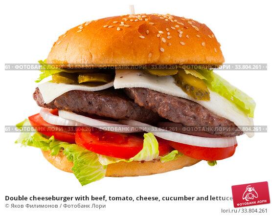 Купить «Double cheeseburger with beef, tomato, cheese, cucumber and lettuce», фото № 33804261, снято 16 июля 2020 г. (c) Яков Филимонов / Фотобанк Лори