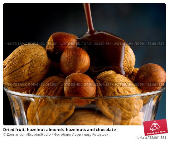 Dried fruit, hazelnut almonds, hazelnuts and chocolate. Стоковое фото, фотограф Zoonar.com/EcopimStudio / easy Fotostock / Фотобанк Лори
