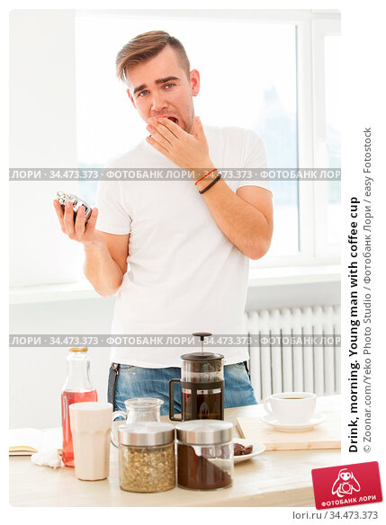 Drink, morning. Young man with coffee cup. Стоковое фото, фотограф Zoonar.com/Yeko Photo Studio / easy Fotostock / Фотобанк Лори