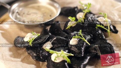 Купить «Dumplings from black dough», видеоролик № 28115929, снято 16 февраля 2018 г. (c) Илья Шаматура / Фотобанк Лори