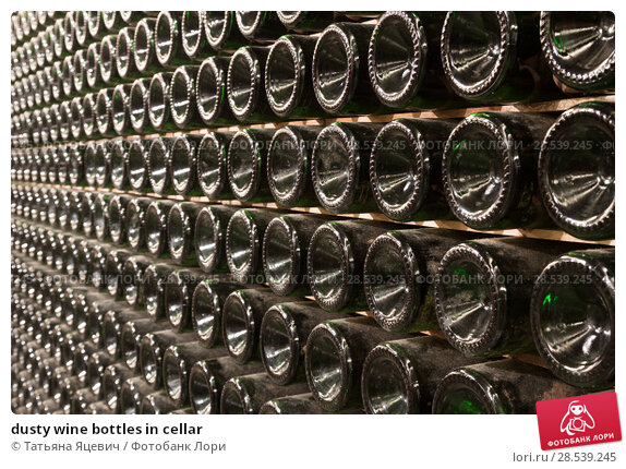 Купить «dusty wine bottles in cellar», фото № 28539245, снято 18 января 2019 г. (c) Татьяна Яцевич / Фотобанк Лори