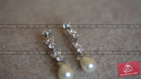 Купить «Earrings with pearls», видеоролик № 25795345, снято 16 марта 2016 г. (c) Алексей Макаров / Фотобанк Лори