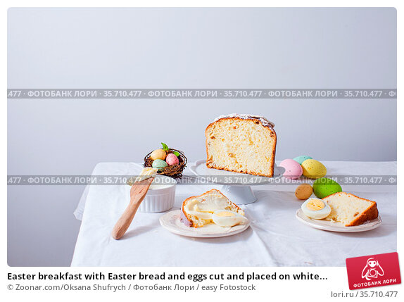 Easter breakfast with Easter bread and eggs cut and placed on white... Стоковое фото, фотограф Zoonar.com/Oksana Shufrych / easy Fotostock / Фотобанк Лори