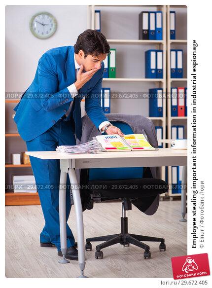 Купить «Employee stealing important information in industrial espionage», фото № 29672405, снято 10 августа 2018 г. (c) Elnur / Фотобанк Лори